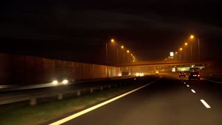 Automobiles riding on highway at night, steadycam shot