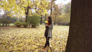 Beautiful woman standing in the park, steadycam shot, slow motion shot at 240fps