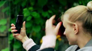 Blonde girl photo of herself on smartphone