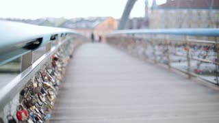 Blurred couple walking on the bridge and woman holding roses