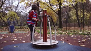 Boy having fun on playground in the park, steadycam, slow motion shot at 240fps