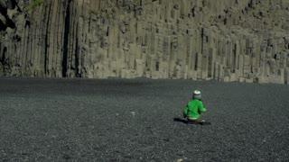 Boy play on Reynisfjara beach at south coast of Iceland, slow motion at 204fps