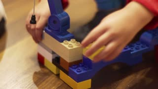 Boy playing with blocks, closeup, steadycam shot, slow motion shot at 100fps