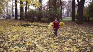 Boy running to the camera in the park, steadycam shot, slow motion shot at 240fps