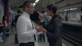 Business colleagues argue on metro station, slow motion shot at 240fps