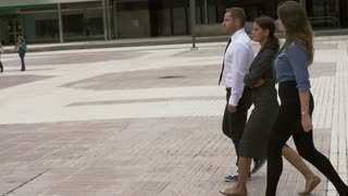 Business people walking on public plaza, slow motion shot at 240fps