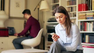 Businesscouple working on modern technology at home