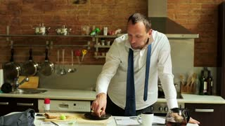 businessman eating breakfast in the kitchen before work