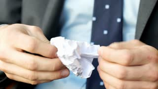 Businessman holding and checking creased paper, steadycam shot