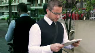Businessman reading newspaper and smiling to the camera, steadycam shot