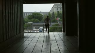 Businessman running through the passage, slow motion shot at 240fps