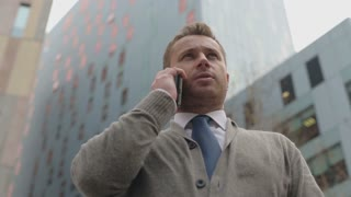 Businessman talking on cellphone in the city