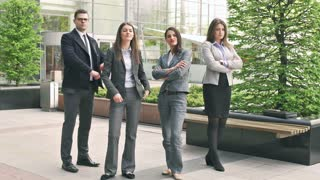 Businesspeople standing and doing serious look to the camera