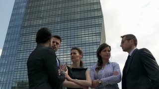 Businesspeople standing outside and having a conversation, steadycam shot