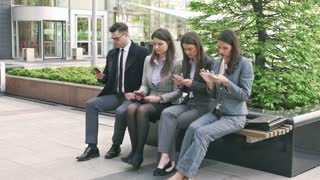 Businesspeople using cellphones and doing serious look to the camera