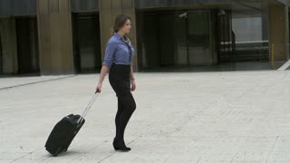 Businesswoman back from vacations going to work, slow motion shot at 240fps