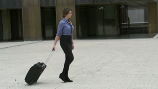 Businesswoman back from vacations going to work, slow motion shot