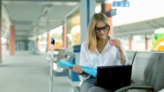 Businesswoman having a videocall on laptop and showing some data