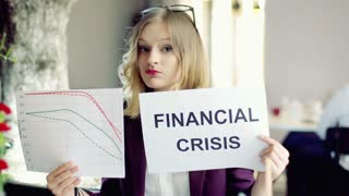Businesswoman looking sad because of financial crisis, steadycam shot