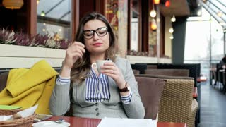 Businesswoman taking off glasses and start relaxing in the cafe