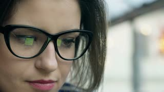 Businesswoman wearing glasses and looking worried in the cafe