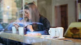 Businesswomen drinking coffee in cafe and relax, steadycam shot.