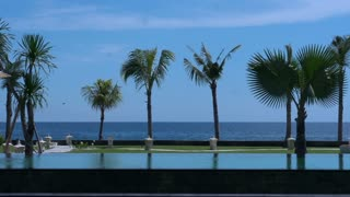 Calm view of the seaside and swimming pool, slow motion shot at 240fps