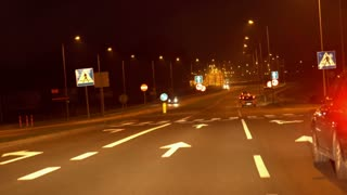 Cars riding on highway at night, steadycam shot