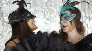 Cheerful women wearing masks at the masquerade party, steadycam shot