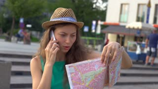 Confused girl lookin on map while talking, steadycam shot, slow motion shot at 2