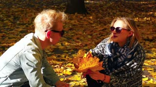 Couple chatting in the autumnal park, steadycam shot, slow motion shot at 240fps