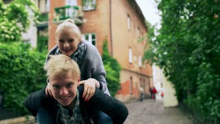 Couple having fun and boy wearing girl on piggyback