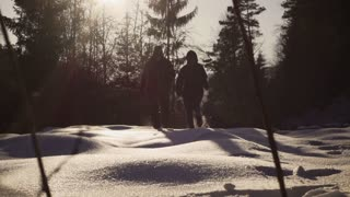 Couple running on the deep snow, steadycam shot, slow motion shot at 240fps