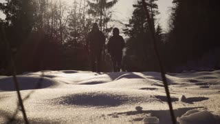 Couple running on the deep snow, steadycam shot, slow motion shot