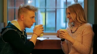 Couple sitting in the cafe and chatting