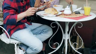 Couple sitting in the restaurant and eating meal