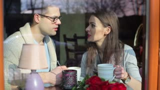 Couple talking and drinking coffee in the restaurant