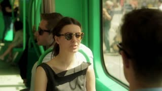Couple talking and sitting in the bus, steadycam shot
