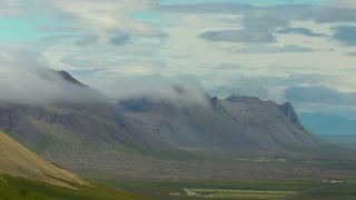 Daytime clouds over mountain in valley Time Lapse, Iceland