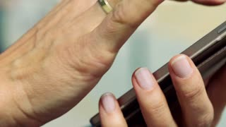 Female hands typing message on smartphone, steadycam shot