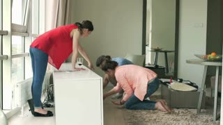 Friends cleaning floor from glass after accident