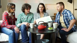 Friends looking on the map and drinking tea