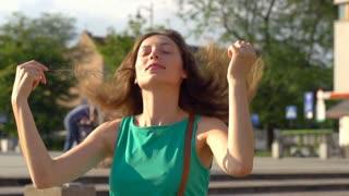 Girl enjoying touching her curly hair, slow motion shot at 240fps