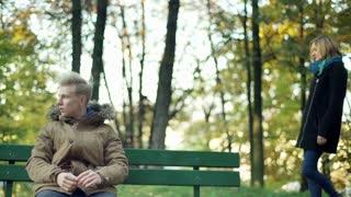 Girl surprising her boyfriend in the autumnal park