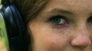 Girl with freckles looking to the camera, closeup, steadycam shot