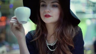Glamorous woman drinking coffee and relaxing