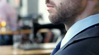 Handsome businessman doing serious look to the camera, steadycam shot