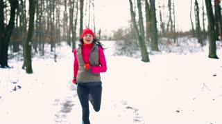 Happy jogger running toward camera, steady, slow motion shot at 240fps