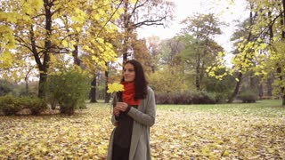 Happy woman standing in the park, steadycam shot, slow motion shot at 240fps