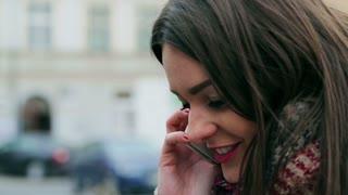 Happy woman talking on cellphone, closeup